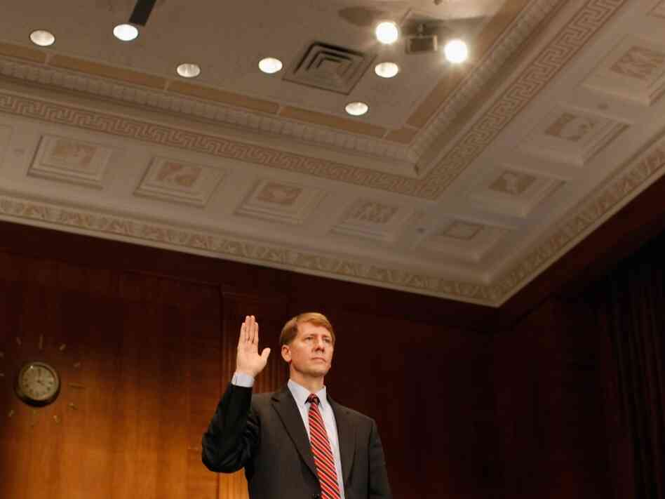 Richard Cordray is sworn in at the beginning of his confirmation hearing before the Senate Banking, Housing and Urban Affairs Committee on Sept 6, 2011. Former Ohio Attorney General Cordray has been nominated by President Barack Obama to be the first director of the United States Consumer Financial Protection Bureau.