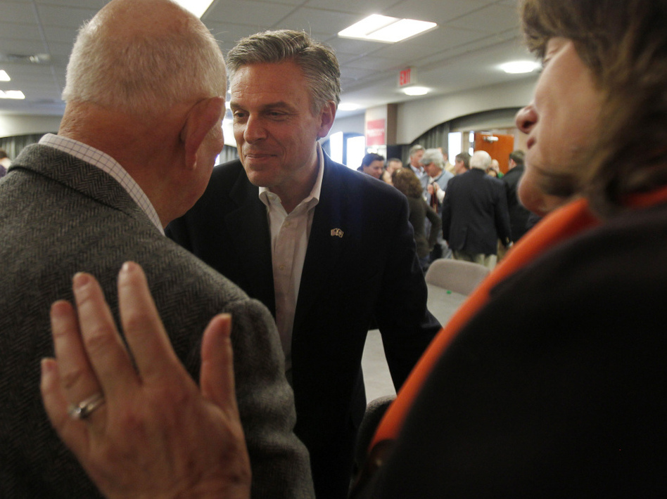 Former Utah Gov. Jon Huntsman shakes hands with voters following a business lunch campaign event in Portsmouth, N.H. on Jan. 5.  (JESSICA RINALDI/Reuters /Landov)