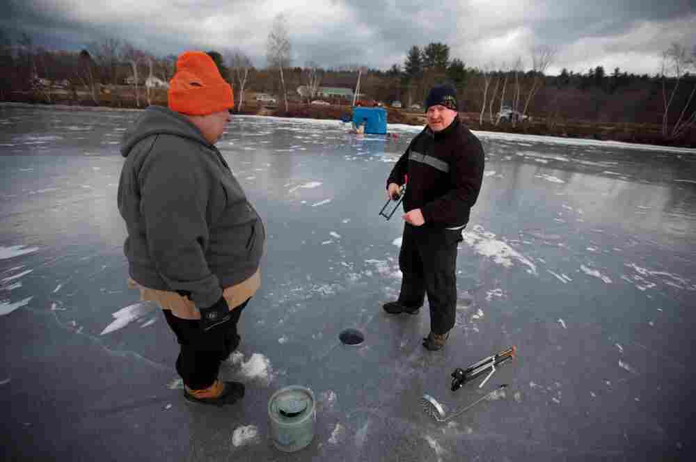 Dan Shaw of the Andover police department sets a line with friend Matt Snow of Belmont, N.H.