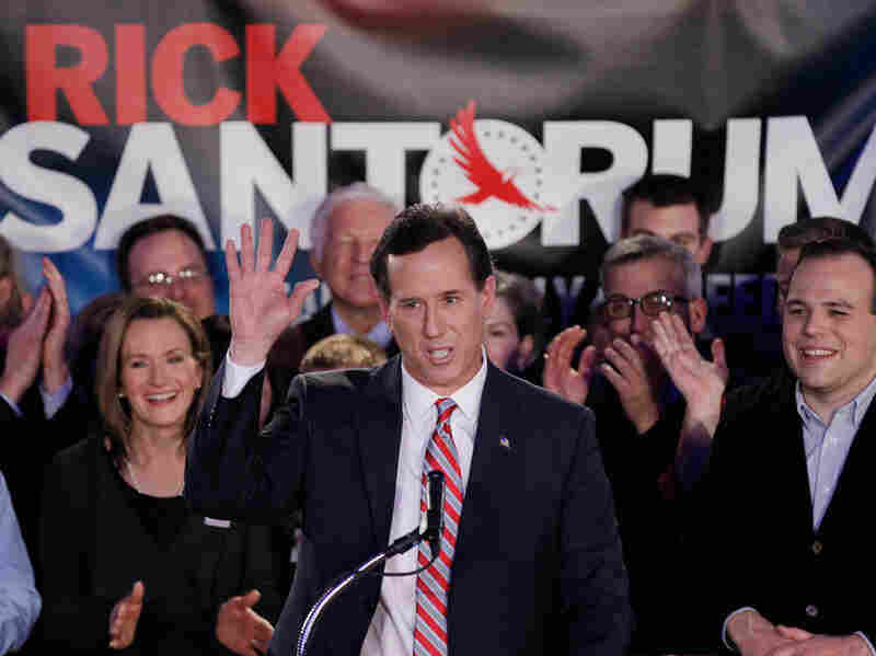 Republican presidential candidate Rick Santorum waves to supporters at his Iowa caucus victory party on Tuesday.