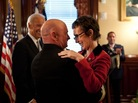 Captain Mark Kelly hugs his wife, Rep. Gabrielle Giffords (D-Ariz.) at the White House in October.