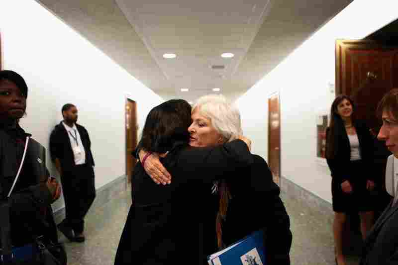 Patricia Maisch (right), who helped disarm Loughner, embraces Georgia Lerner, whose mother died in the shooting. Maisch testified on Capitol Hill in support of a bill to strengthen background checks for people who buy firearms.