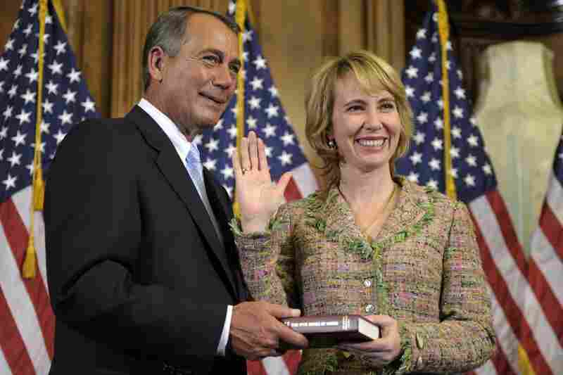 Giffords reenacts her swearing-in with House Speaker John Boehner. The Democrat has represented Arizona's 8th congressional district since 2007.