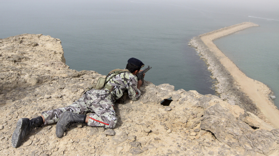 A member of the Iranian military takes position in a military exercise on the shore of the Sea of Oman in December. (AP)