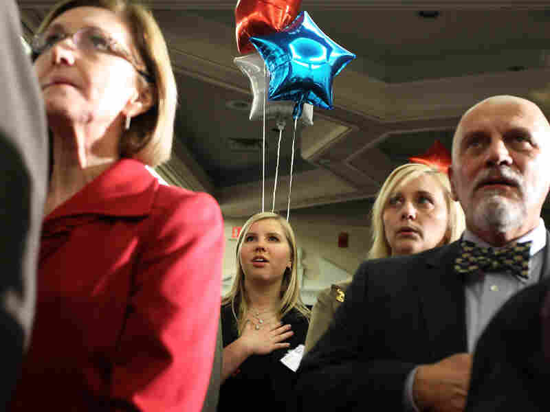 Participants recite the Pledge of Allegiance during the Hillsborough County Republican Gala Friday in Nashua, New Hampshire.