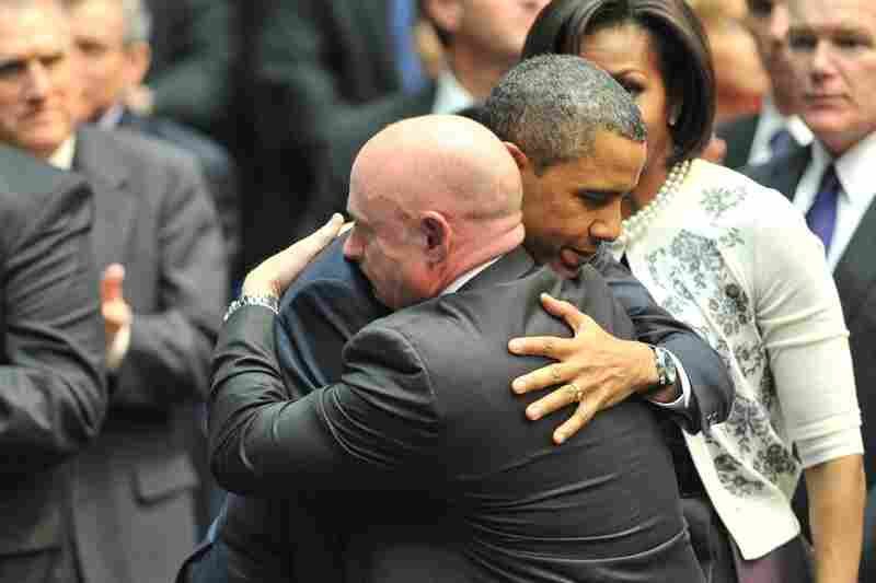 """President Obama hugs Kelly during a memorial service, """"Together We Thrive: Tucson and America,"""" at the McKale Memorial Center in Tucson on Jan. 12."""