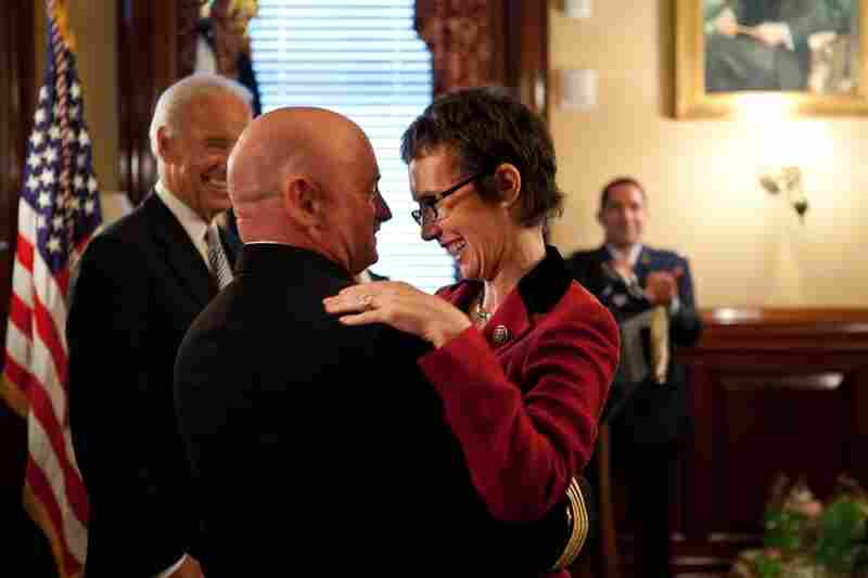 Kelly hugs his wife after receiving the Legion of Merit from Vice President Joe Biden during a retirement ceremony on Oct. 6.
