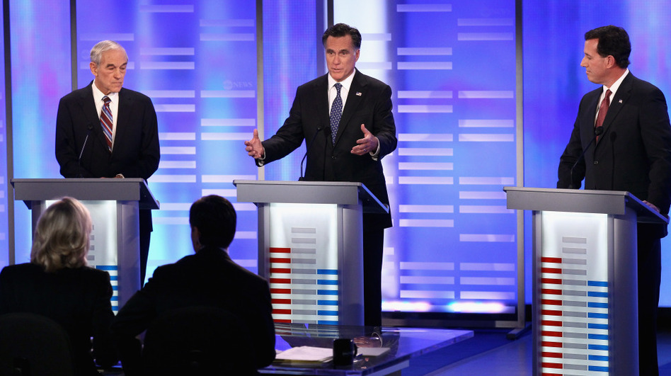 Republican presidential candidates (from left) Ron Paul, Mitt Romney and Rick Santorum participate in the ABC News, Yahoo! News and WMUR Republican Presidential Debate at Saint Anselm College on Saturday in Manchester, N.H. (Getty Images)