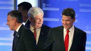 Former Utah Gov. Jon Huntsman, former Massachusetts Gov. Mitt Romney, former House Speaker Newt Gingrich and Texas Gov. Rick Perry (left to right) take their positions after a break in a debate in Manchester, N.H., Saturday.