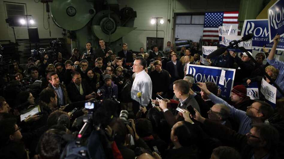 Former Massachusetts Gov. Mitt Romney speaks to reporters in Hudson, N.H., Monday, where he said opponents were taking his words out of context. (Charles Dharapak/Associated Press)