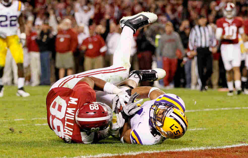 Not Giving An Inch: You can expect to see lots of close contact in Monday's BCS national title game. Here, Eric Reid of the LSU Tigers defends against Michael Williams of the Alabama Crimson Tide.