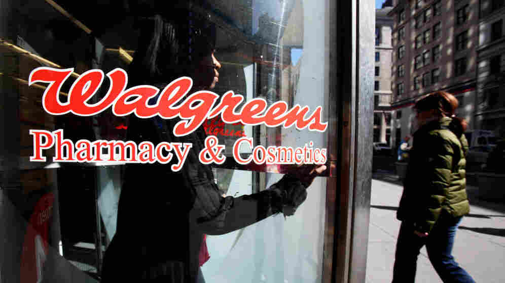 A customer walks out of a Walgreens store in New York City.