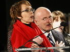 Rep. Gabrielle Giffords (D-Ariz.) and her husband, Mark Kelly, as they recited the Pledge of Allegiance at Sunday's memorial service in Tucson.