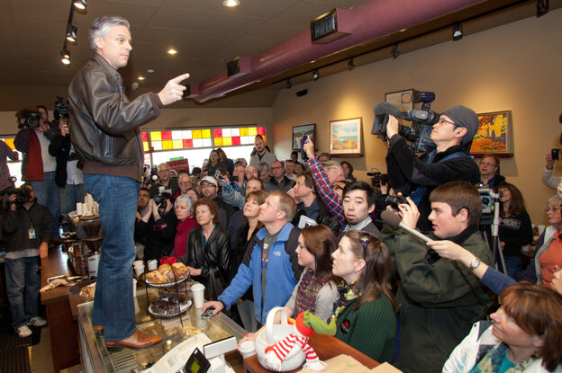 Republican presidential candidate Jon Huntsman campaigns from the counter at the Bean Towne Coffee House & Cafe in Hampstead, N.H., on Jan. 8. Polls show Huntsman gaining on front-runner Mitt Romney ahead of Tuesday's primary.