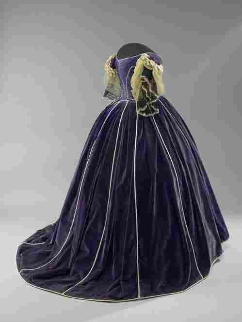 Mary Todd Lincoln's mid-19th century gown is accentuated by its lush purple velvet and mother of pearl buttons. It was thought to have been worn during the winter social season and was made by a slave named Elizabeth Keckley. After buying her freedom, Keckley set up a dressmaking business and became one of the first lady's closest confidantes.