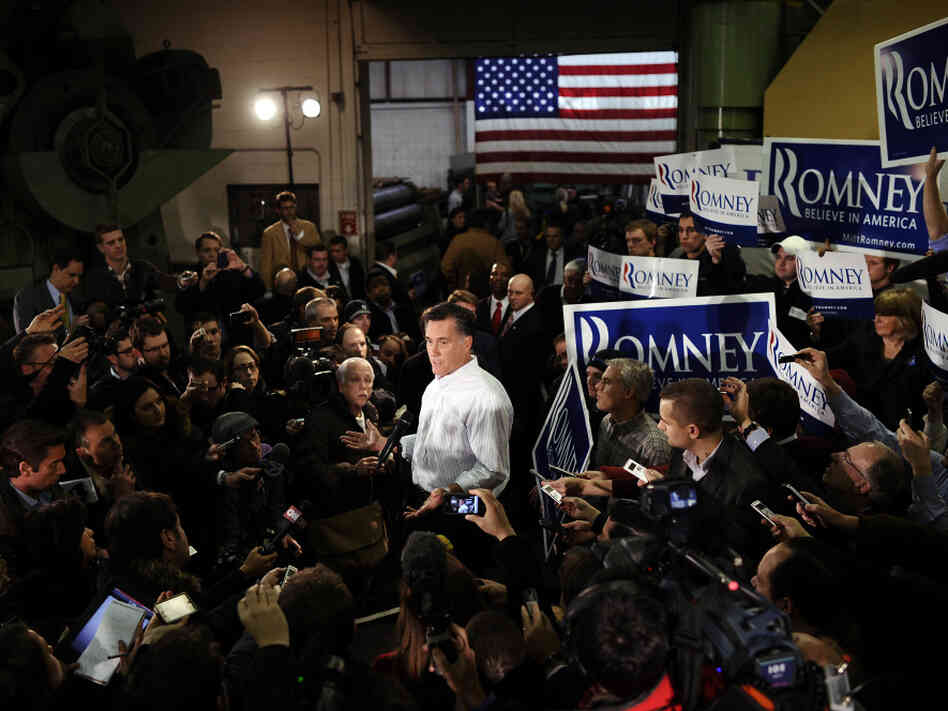 Republican presidential hopeful Mitt Romney talks to the press after speaking at Gilchrist Metal Fabricating in Hudson, N.H., on Jan. 9.