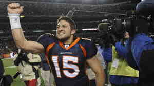 Denver Broncos quarterback Tim Tebow celebrates after beating the Pittsburgh Steelers 29-23 in overtime of an NFL wild card playoff football game on Sunday, (Jan. 8, 2012).