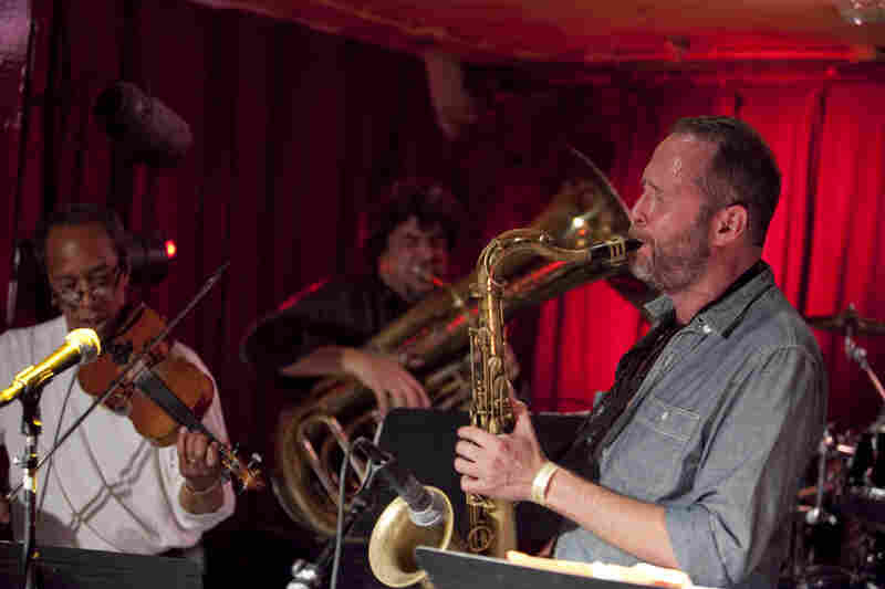 Michael Blake (right) performed with his band Hellbent, featuring Charlie Burnham on violin and Marcus Rojas on tuba.
