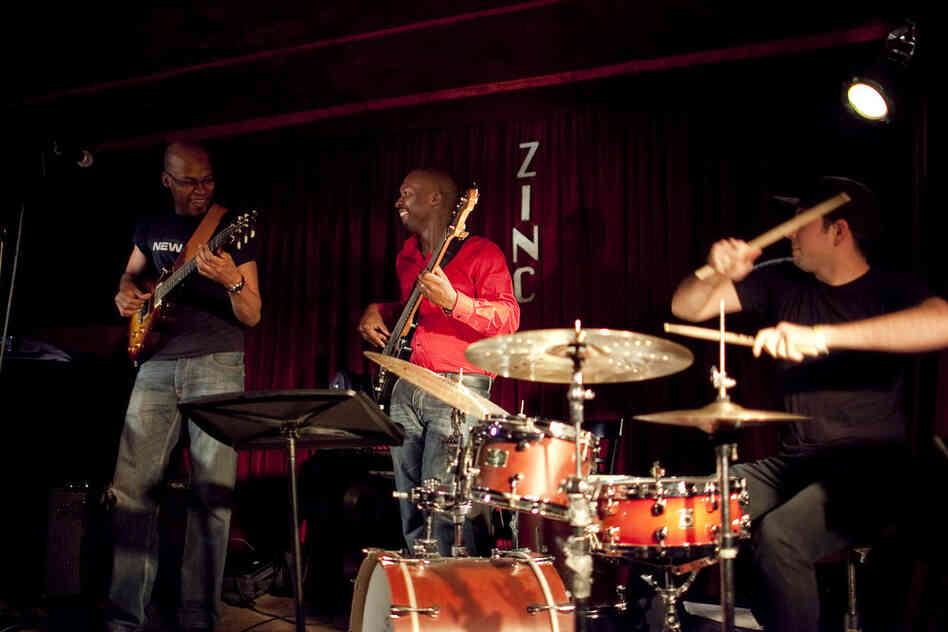 Inside Zinc Bar, guitarist Lionel Loueke (left) played material from his upcoming album, with a new band of Michael Olatuja (bass) and Mark Guiliana (drums).
