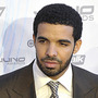 Drake poses on the red carpet at the 2011 Juno Awards (Canada's Grammys) in Toronto, flanked by two members of the Royal Canadian Mounted Police.