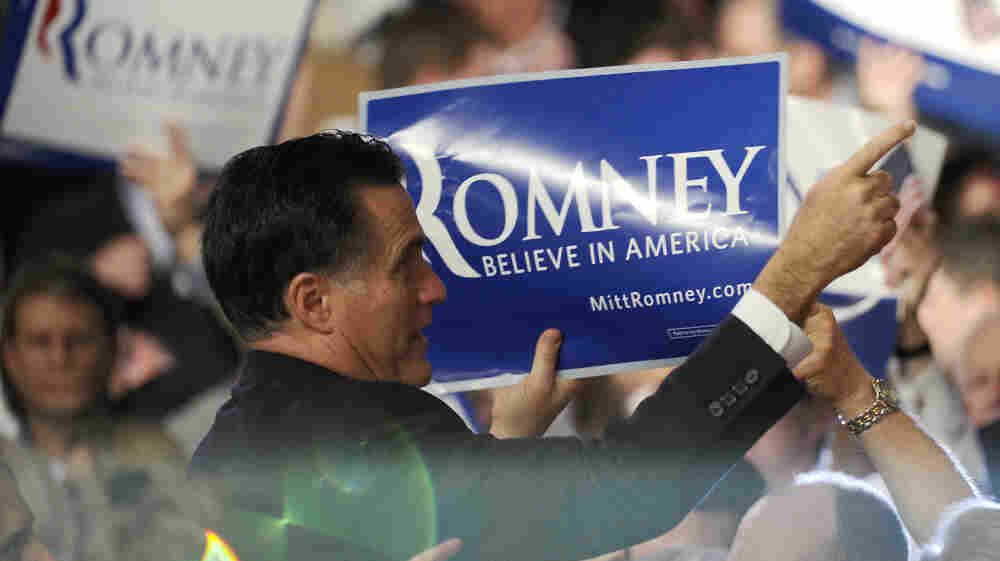 Mitt Romney greets supporters in Manchester, N.H., after winning the New Hampshire primary.