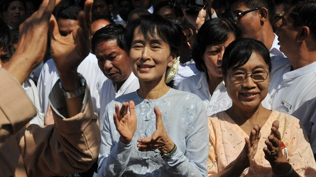 Myanmar democracy icon Aung San Suu Kyi, center, at an campaign event on Tuesday.
