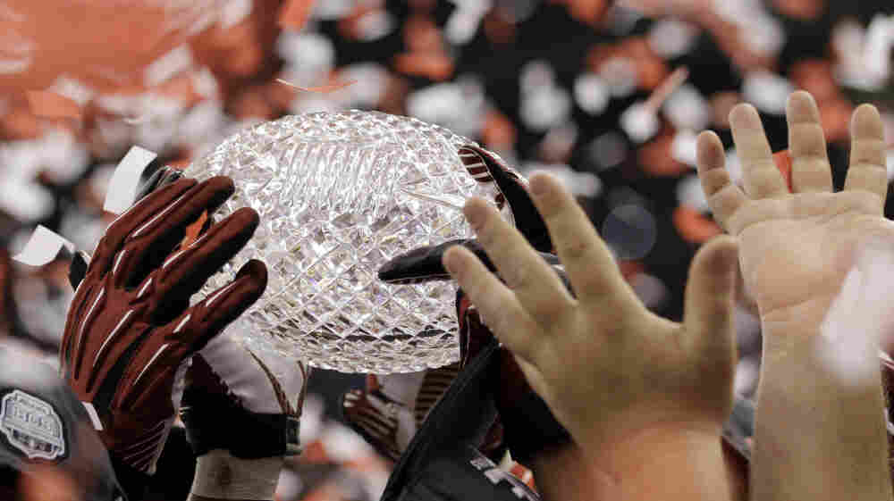 Alabama players celebrates with their trophy after the BCS National Championship college football game against LSU on Monday.