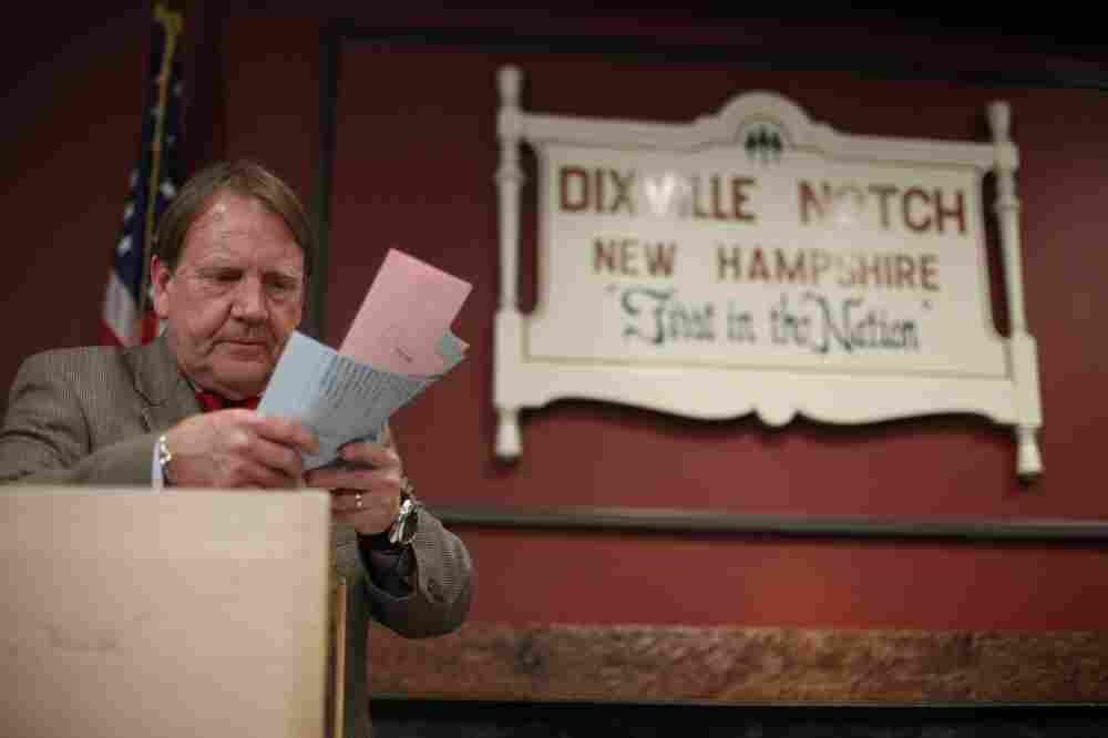 Tom Tillotson removes ballots for counting after midnight Tuesday in Dixville Notch, N.H.