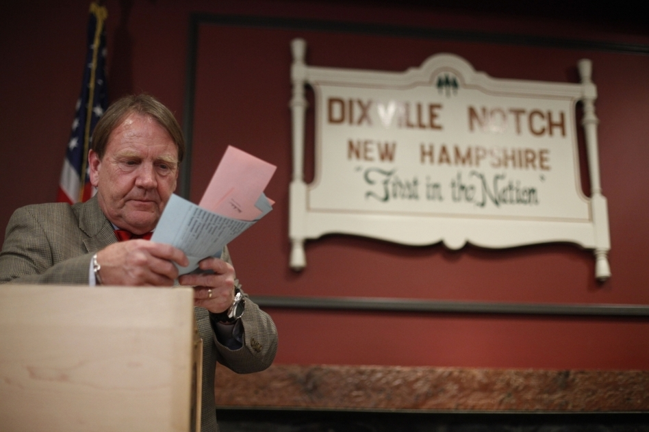 Tom Tillotson removes ballots for counting after midnight Tuesday in Dixville Notch, N.H. (Matt Rourke/AP)