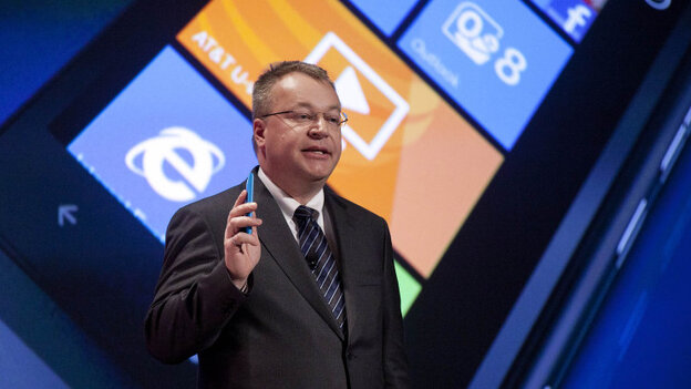 Nokia President and CEO Stephen Elop introduces the Lumia 900 smartphone during a CES news conference in Las Vegas.
