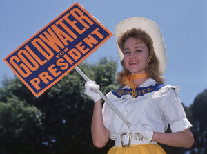 July 1964: A Goldwater girl campaigning for Barry Goldwater, the Republican Presidential candidate, in Sherman Oaks, California. Goldwater was widely considered to be an extremist candidate.