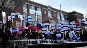 Supporters for various candidates hold signs at the Webster School polling location in Manchester, N.H., on Tuesday.