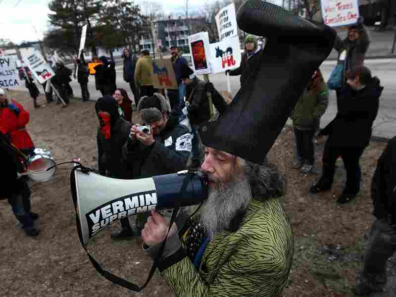 Fringe candidate Vermin Supreme demonstrates with Occupy protesters on Sunday, outside a restaurant where Republican presidential candidate Newt Gingrich held a town hall meeting in New Hampshire.