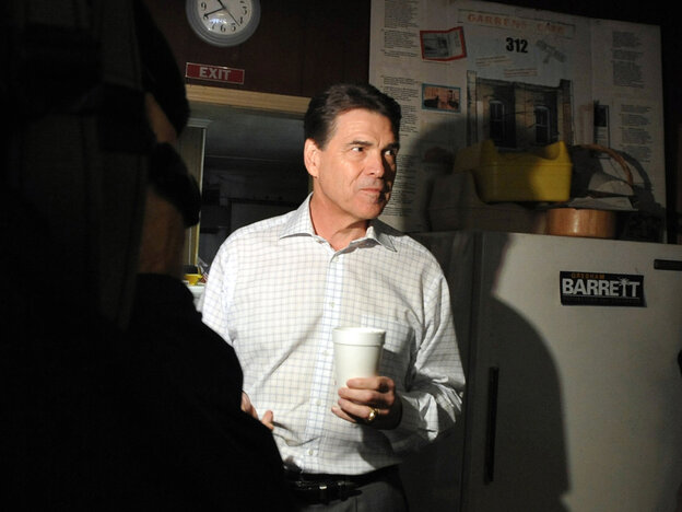 Texas Gov. Rick Perry campaigns in South Carolina on Jan. 9. Perry is suing Virginia to get his name on its March 6 primary ballot.