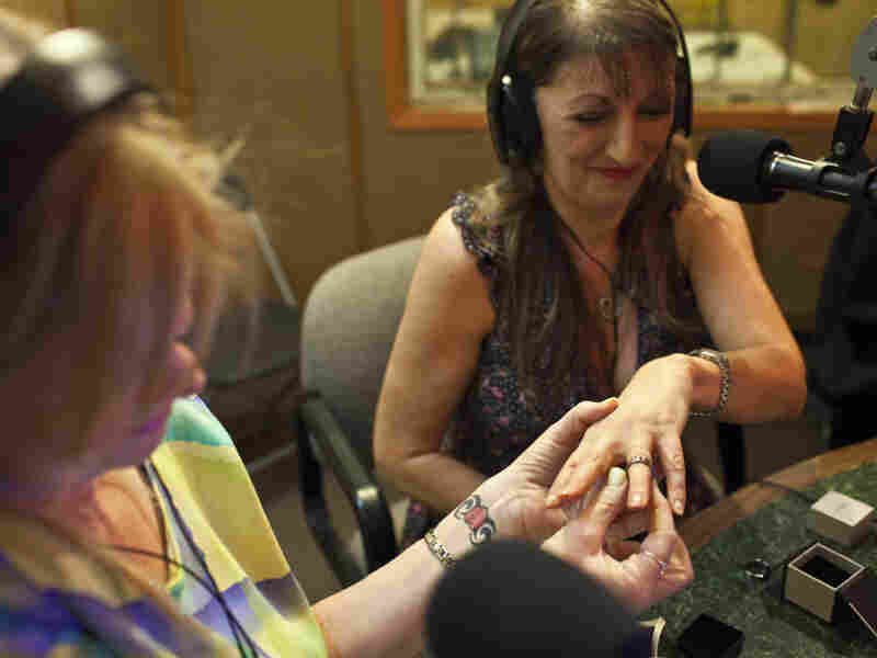 Janice Oeffner places a ring on the finger of Dawn Williams during an on-air proxy wedding between Williams and a Texas inmate. On-air proxy weddings have become so common that The Prison Show has a wedding coordinator to help guide couples through the paperwork.