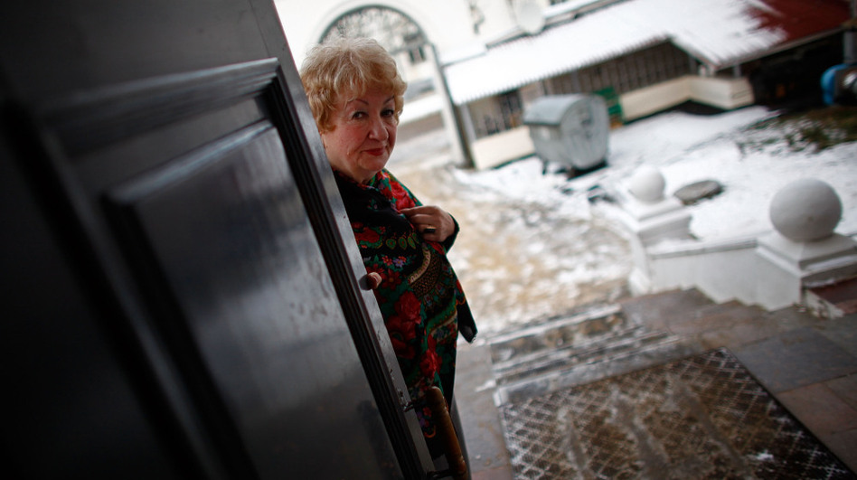 "Ella Stroganova opens the door at the city museum in Yaroslavl, Russia, where she serves as curator. ""Progress makes person absolutely weak,"" Stroganova said. ""He loses his strength because he doesn't need to think how to survive."""
