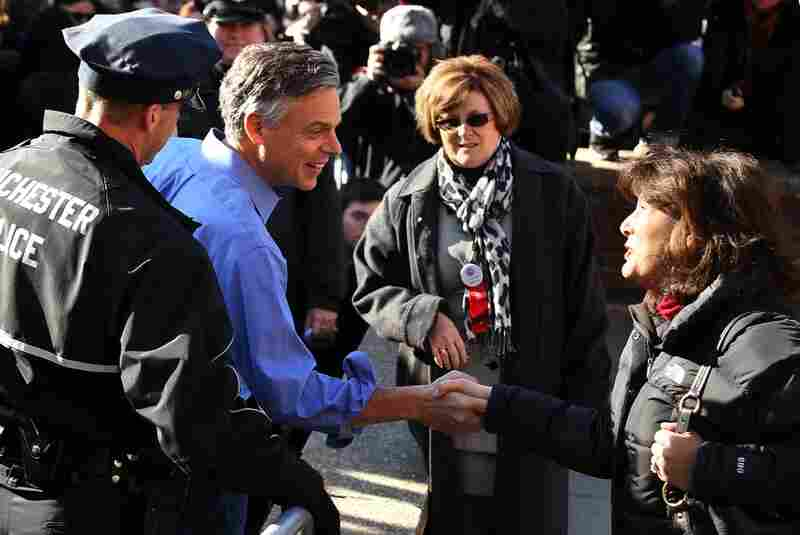 Jon Huntsman greets voters at a polling place in Manchester.