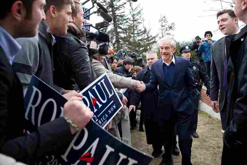 Ron Paul greets supporters outside Webster School.