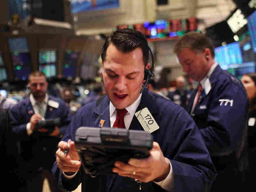 NEW YORK, NY - DECEMBER 20: Traders work on the floor of the New York Stock Exchange on December 20, 2011 in New York City.