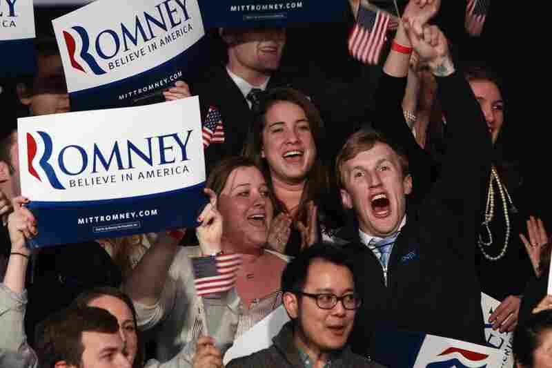 Romney supporters celebrate the news of his win.