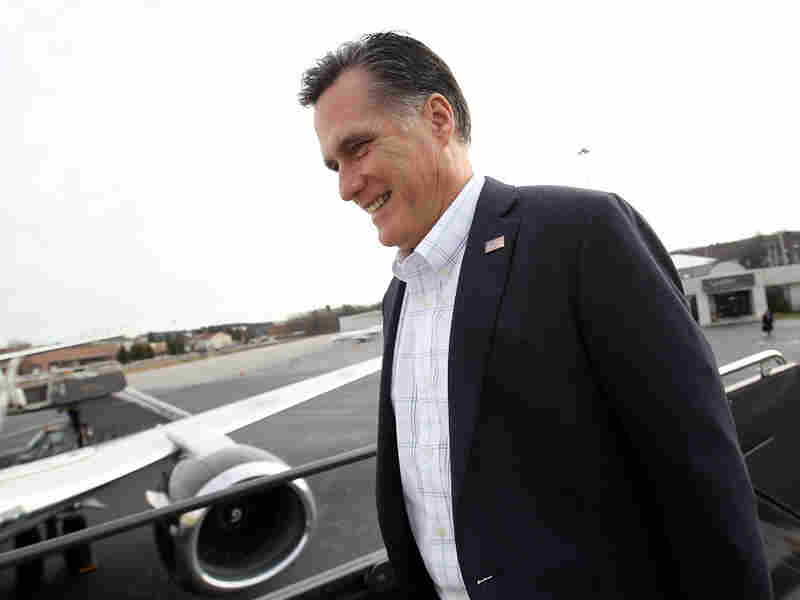 Republican presidential hopeful Mitt Romney boards his campaign plane in Bedford, Mass., on Wednesday, heading for South Carolina. Romney brings momentum from Iowa and New Hampshire, but South Carolina is new terrain — a place where Romney is going to have to appeal to religious conservatives and Tea Party voters.
