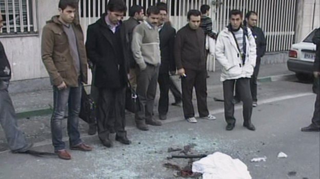 An image grab taken from footage broadcast by Iran's state-run Arabic-language Al-Alam TV shows blood stains covered by a piece of cloth and debris at the site of the car bomb. (AFP/Getty Images)
