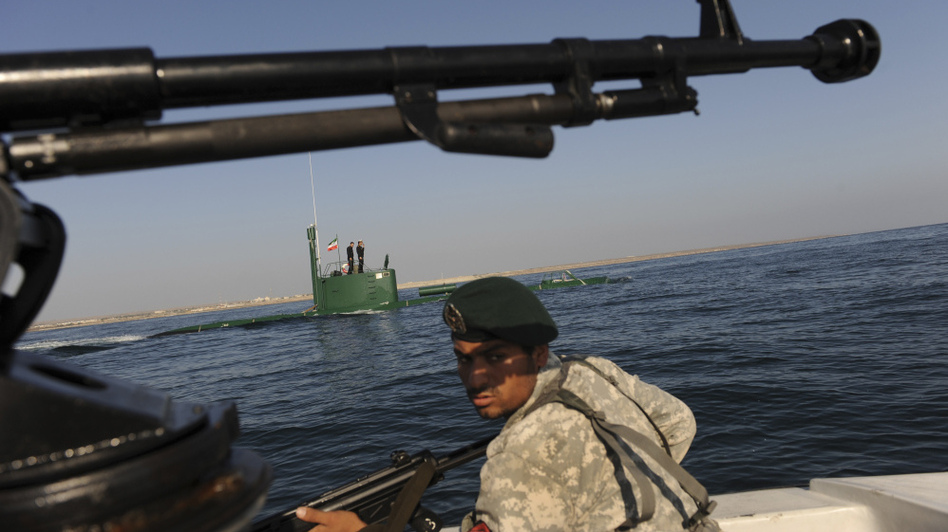 A member of Iran's navy participates in a drill on Dec. 28, 2011, in the Sea of Oman. Tehran is threatening to close the strategic Strait of Hormuz at the mouth of the Persian Gulf, in retaliation for new sanctions by the West. (AP)