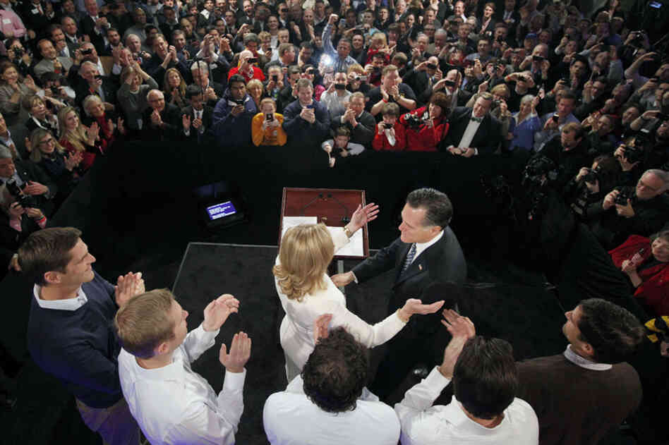 Mitt Romney reaches for his wife, Ann, as his sons, Josh, Ben, Craig, Tagg and Matt (left to right) look on during a primary night rally at Southern New Hampshire University in Manchester, N.H., on Tuesday evening.