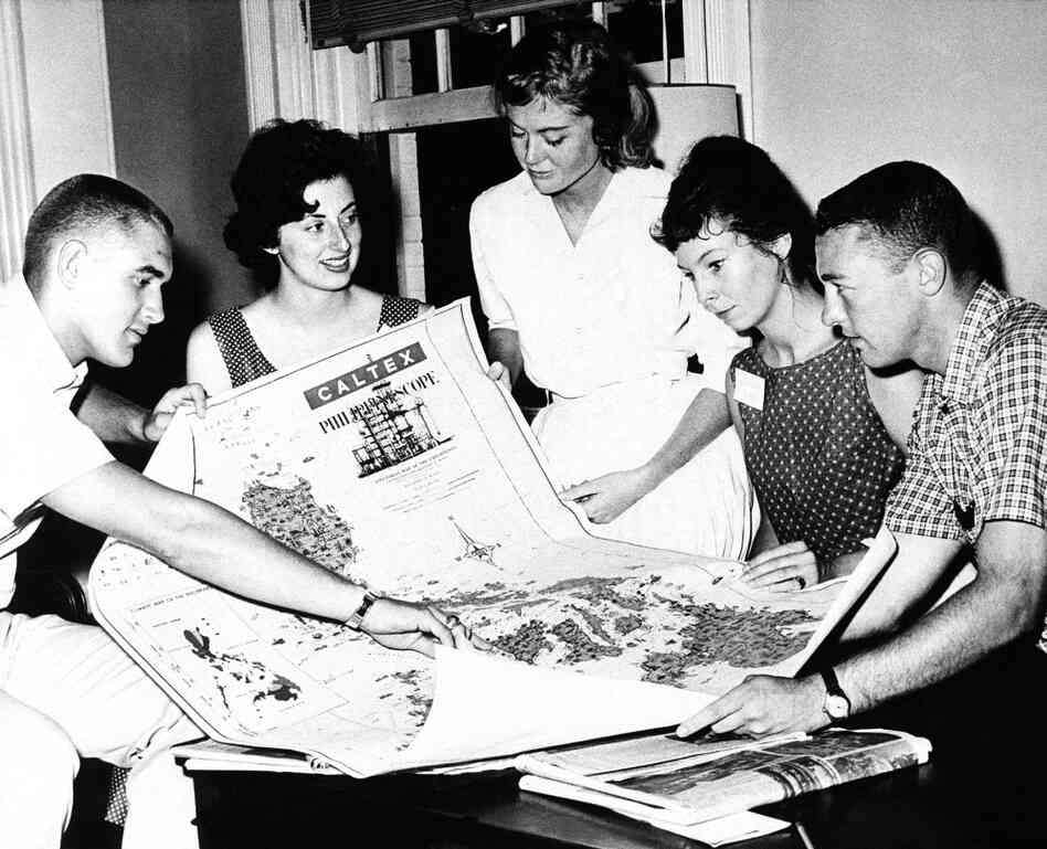 Five Peace Corps trainees look at a map of the Philippine Islands in University Park, Pa. on July 31, 1961. The trainees will go there upon completion of training as teaching assistants in