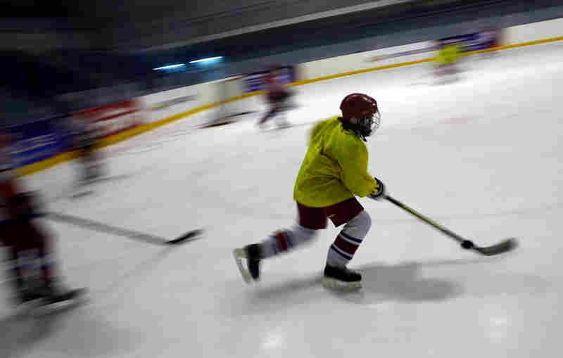Boys chase the puck during a training session at the rink in Yaroslavl, about four hours northeast of Moscow by train.