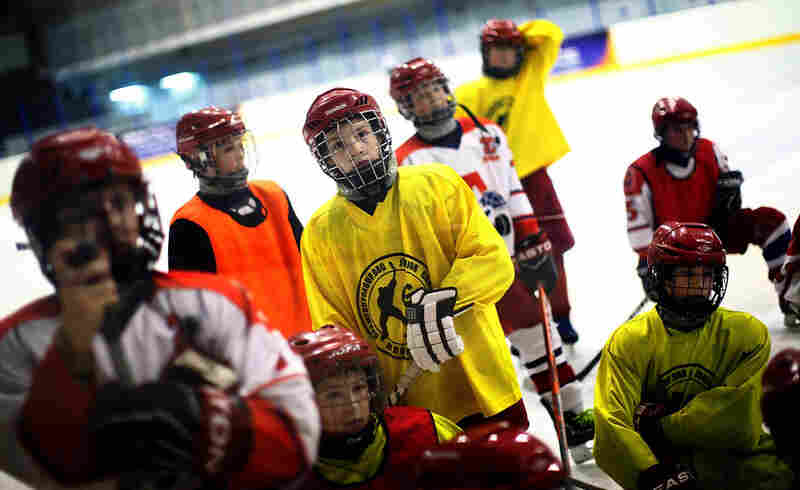 During practice, the 20 or so 11-year-old boys in the training program listen to their coach, Ivan Dobryakov.