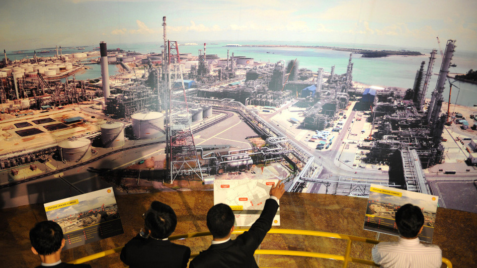 Visitors view a photo montage of Royal Dutch Shell's Ethylene Cracker Complex during its opening ceremony in Singapore in 2010. The company is expected to announce plans soon for an ethylene cracker plant in Ohio, Pennsylvania or West Virginia.