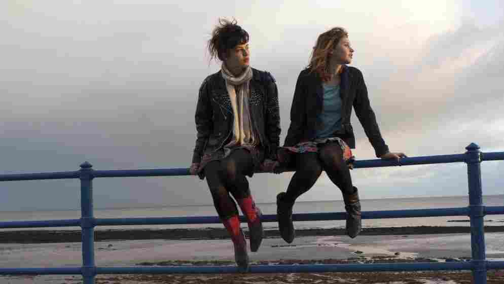 Two Collaborators: Free-spirited teen Emelia (Jessica Brown Findlay, left) becomes fast friends with timid, strait-laced Beth (Felicity Jones, right) in Albatross.