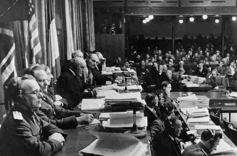 Members of the tribunal (left), preside over the Nuremberg war crimes trials in 1946. In his new book, Justice and the Enemy, journalist William Shawcross describes how the Nuremberg trials set a template for the trials of future war crimes.